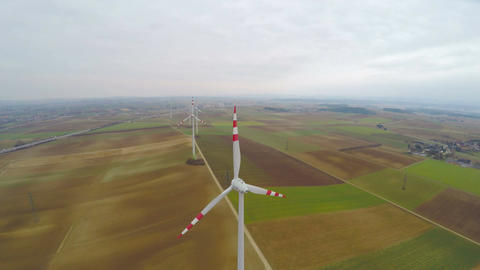 Aerial shot of rotating wind turbines. Rainy weather. Energy self-sufficiency Footage