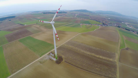 Huge spinning blades of wind turbine in countryside, aerial. Power generation Footage