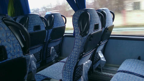 Empty seats inside a low-budget bus, traveling in economy class. Tourism Footage