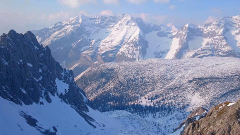 Mountain hills and valley covered with snow. Sunny weather. Horizontal panorama Footage