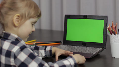 Children distance education on laptop during online lesson at home. Green screen Live Action