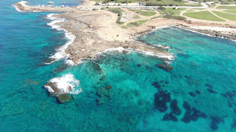 Top view of deserted sea spit with transparent ocean waters around. Aerial view Live Action