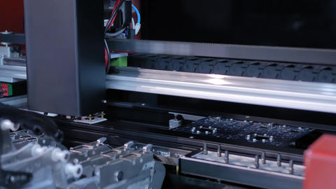 Automatic SMD pick and place machine assembling computer printed circuit board Live Action