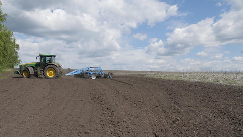 Disking the soil. Short disc harrow. Work of agricultural machinery in the field Live Action