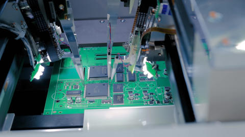 Quality testing of printed circuit boards - flying probe test at factory Live Action
