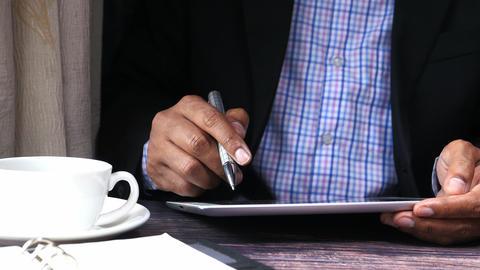 Businessman in suit working on digital tablet Live Action