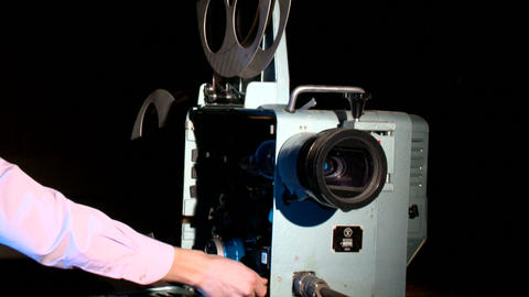 old cinema projection device demonstrates a film Live Action