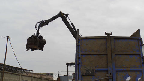 Claws of mechanical moving arm in scrapyard Live Action