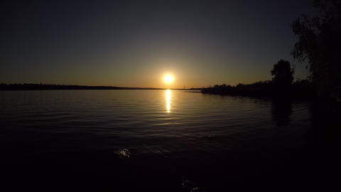 sunset on the river a quiet place of petty ripples on the water camera smoothly Live Action