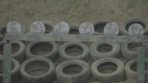 Iron targets during the shooting. Slow motion Live Action