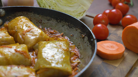 Stuffed cabbage is cooked in a pan, close-up Live Action