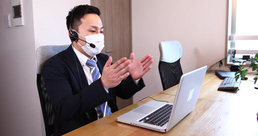 Office worker remote work video conference male business meeting office computer female Live Action