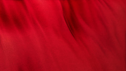 Seamlessly looping red flag cloth in full frame with selective focus Animation