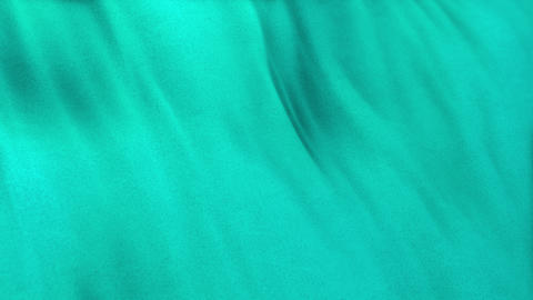 Seamlessly looping turquoise flag cloth in full frame with selective focus CG動画