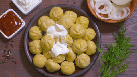 Georgian national dish Khinkali. Laid on a clay plate Live Action
