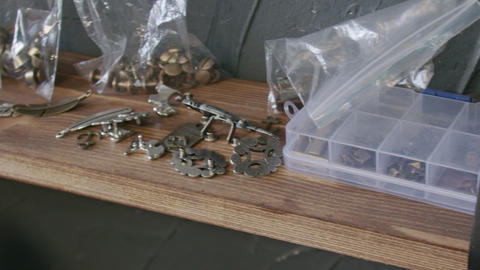 Metalworking accessories for leatherworking on a wooden shelf. Working process Live Action