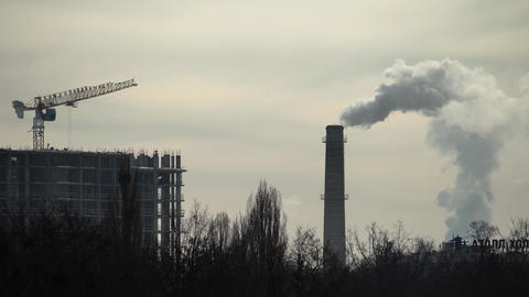 Smoke comes from the chimney. Air pollution. Ecology. Kyiv. Ukraine Live Action