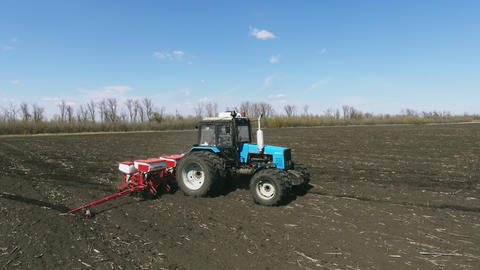 Tractor with special precision planters, seeder is working in the field Live Action