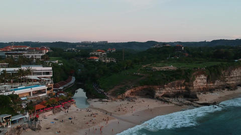 drone drone from Dreamland beach in the evening large ocean waves visible Live Action
