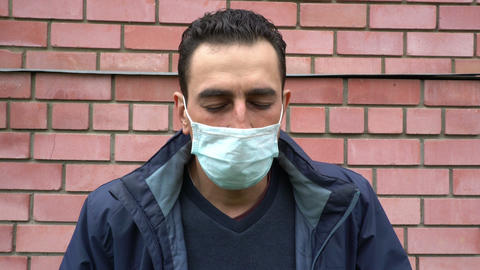 Man in medical mask cant breath, choking, suffocating, ill, heavy cough Live Action