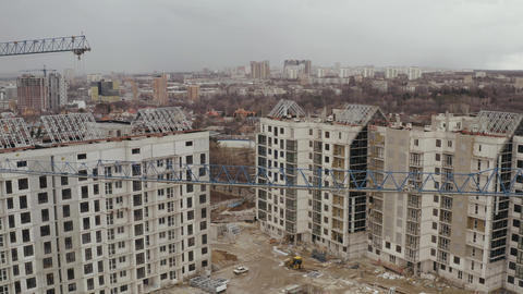 Aerial shot of construction cranes and the construction of a number of new Live Action