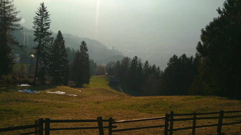 Little village in mountain valley on sunny spring day. Magnificent landscape Footage