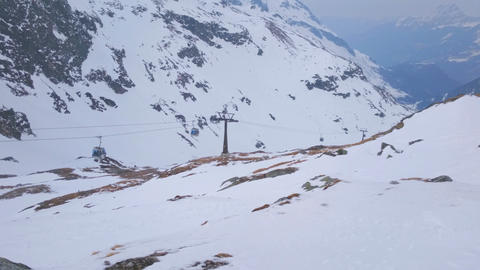 Cable cars moving at ski resort. Mountains covered with snow, winter landscape Footage