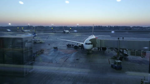 Passengers boarding flight, plane before takeoff, timelapse of airport at dusk Footage