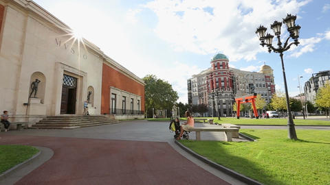 Facade of Bilbao Fine Arts Museum, people having rest at nice sunny city park Footage