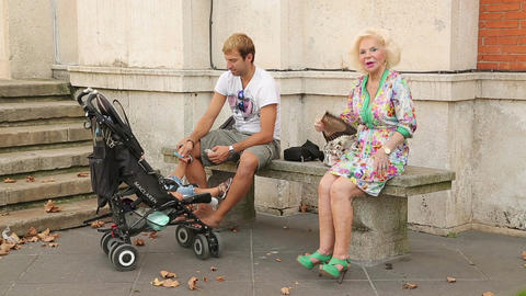 Glamorous senior lady sitting on the bench, father and kid having rest in park Footage
