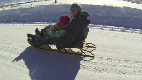 Mother kids winter recreation sled ride rural road winter HD 005 Footage