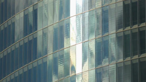 Glass wall of modern high-rise business center, office building in city center Footage