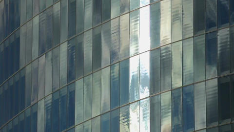 Establishing shot of modern glass building wall, windows of company offices Footage