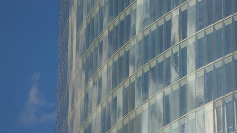 Bright blue sky reflection in window glasses of modern multi-storeyed building Footage