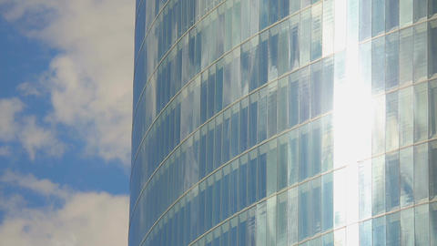 Vertical pan shot of modern glass building, windows of office center, sunny day Footage