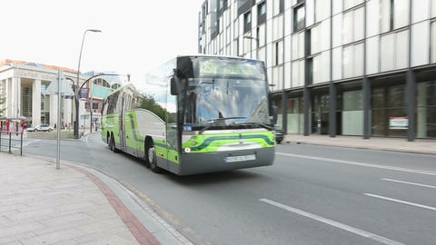 Intensive road traffic in city street, comfortable bus transporting passengers Footage