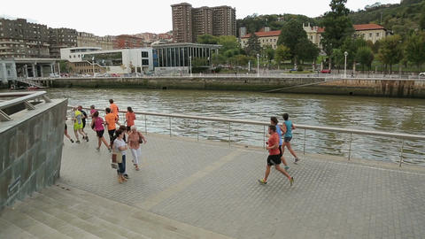People running at riverside, healthy lifestyle promotion campaign in big city Footage