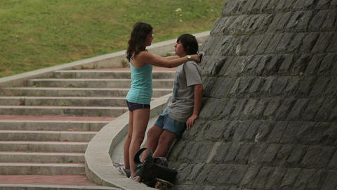 Teenage couple hugging in the street, first love, transitional age psychology Live Action