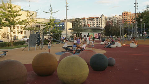 Crowd of kids having fun on playground, summer holidays, childhood in big city Footage
