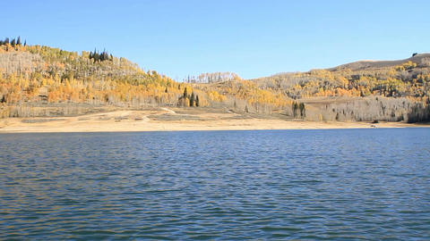 Mountain lake in autumn from boat P HD 7998 Live Action