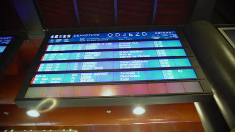 Train schedules on dynamic display at railway station, information for travelers Footage