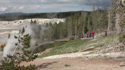 Norris Geyser Basin tourists run through steam Yellowstone 4K Footage