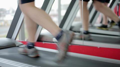 Beginner athlete walking and running on treadmill, sport club visitor exercising Footage