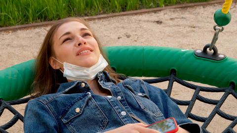 Content woman in medical mask enjoying fresh air Live Action