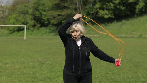 Active senior elderly 80 years old caucasian woman do morning physical exercises Live Action