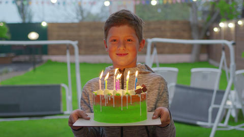 Happy little boy blowing birthday candles. Happy birthday Live Action