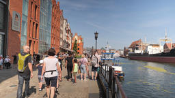 Tourists strolling in the old town of Gdansk, Poland Live Action