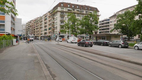 Place des Augustins (time lapse) with traffic, tramways and pedestrians passing Live Action