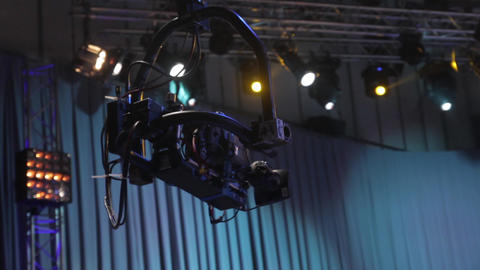 A crane with a camera on a suspension in a TV studio during a tv broadcast Live Action