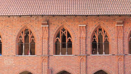Teutonic order castle in Malbork. Windows of the cloisters of the high castle Live Action